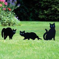 Atrapy koček z voděodolného černého kovu s blyštivýma očima